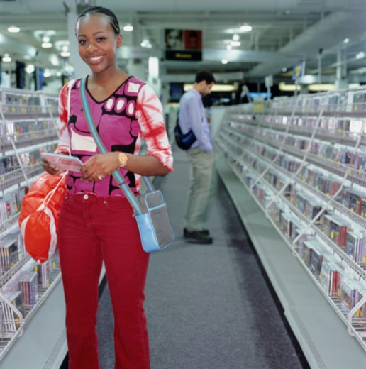Stock Photo: 1598R-65870 Young woman standing in music shop, portrait