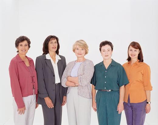 Stock Photo: 1598R-66038 Five women standing side by side, posing in studio, portrait
