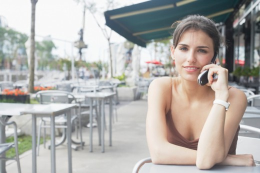 Stock Photo: 1598R-67330 Portrait of a young woman talking on a mobile phone