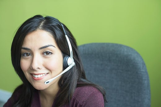 Stock Photo: 1598R-67673 Portrait of a customer service representative smiling