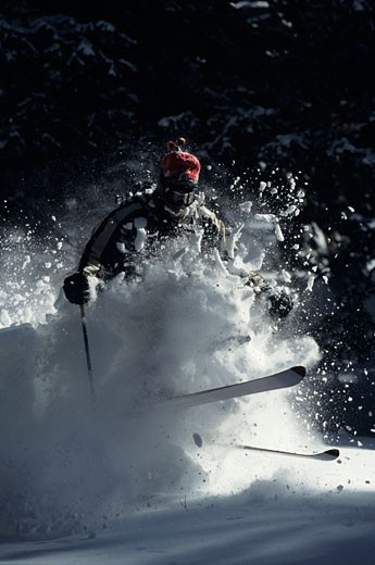Man skiing with big powder spray : Stock Photo