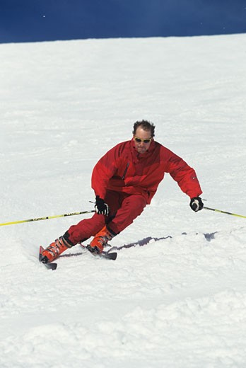 Man downhill skiing : Stock Photo
