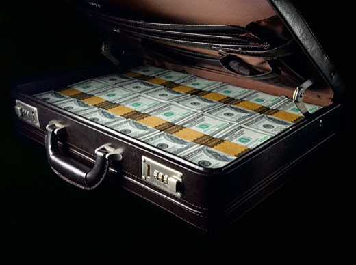 Stock Photo: 1598R-68394 Briefcase filled with one hundred US dollar bills