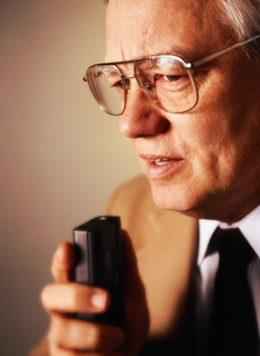 Businessman Speaking into a Tape Recorder : Stock Photo