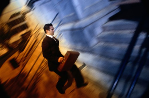 Businessman Running Up Steps : Stock Photo