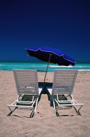 Stock Photo: 1598R-70607 Rear View of Beach Chairs on the Beach