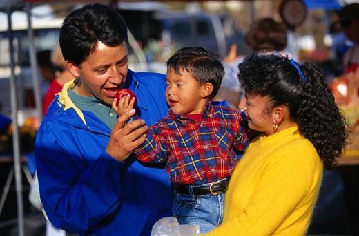 Stock Photo: 1598R-71222 Hispanic Family Shopping at a Farmer's Market