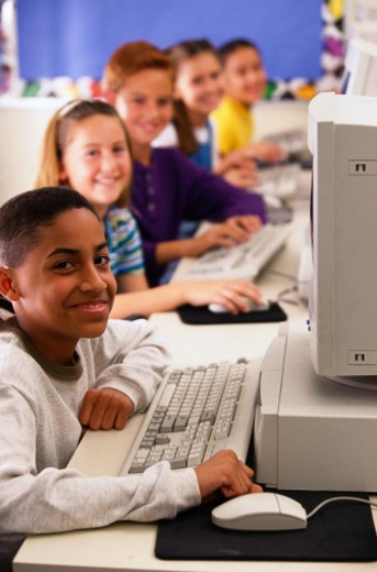 Students Smiling in a Computer Lab : Stock Photo