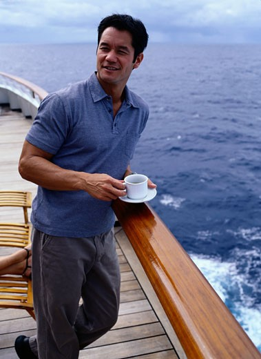 Man on Rear Deck of Cruise Ship : Stock Photo