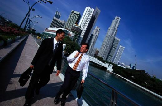 Businessmen Talking Near River, Singapore : Stock Photo