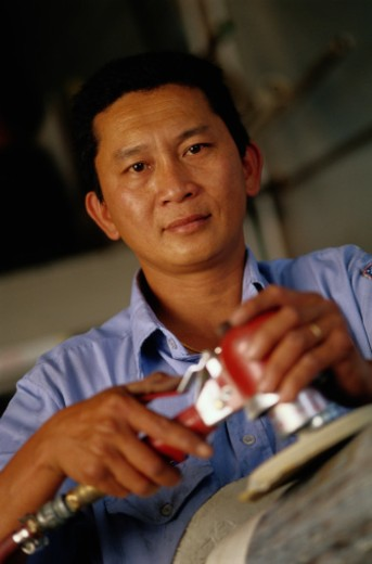 Stock Photo: 1598R-73383 Male Mechanic, Portrait