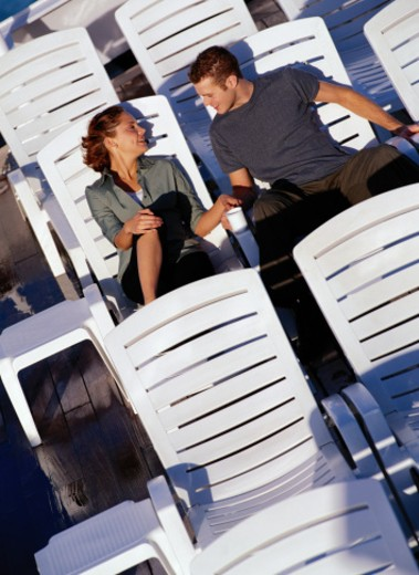 Young Couple Sitting on a Cruise Ship Deck : Stock Photo