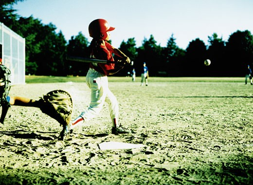 Stock Photo: 1598R-74109 Youth League Player Batting