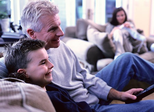 Grandfather and Grandson Watching Television : Stock Photo