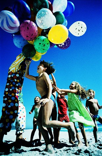 Children and a Bunch of Balloons : Stock Photo