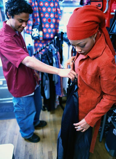 Stock Photo: 1598R-74762 Young Couple Shopping for Clothes
