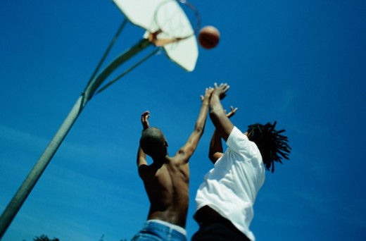 Stock Photo: 1598R-74834 Father and Son Playing Basketball