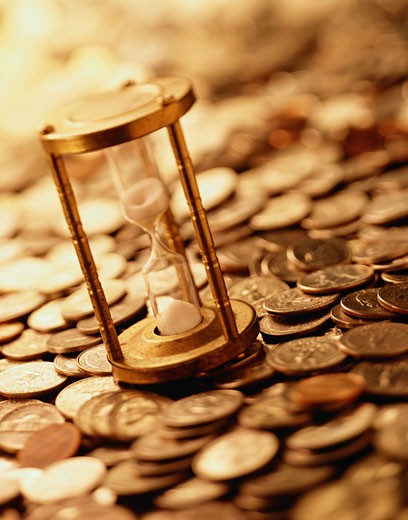 Hourglass and Coins : Stock Photo