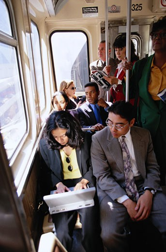 Businesspeople on Train : Stock Photo