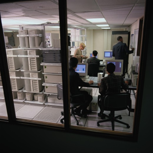 Stock Photo: 1598R-79292 Businesspeople in Network Server Room