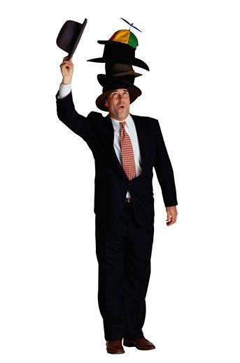 Man Wearing Many Hats : Stock Photo