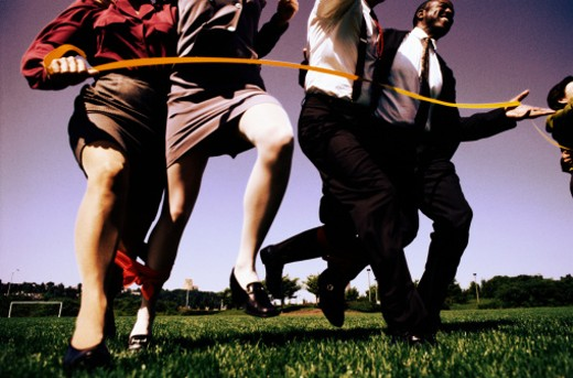 Stock Photo: 1598R-79641 Businesspeople Finishing a Three-legged Race