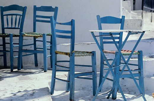 Greece, Aegean, Mikinos, tables and chairs outside cafe : Stock Photo