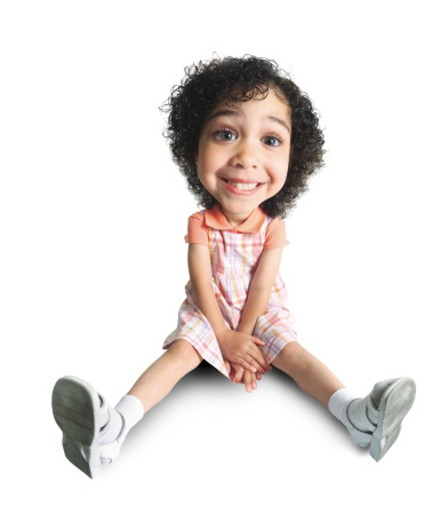 Stock Photo: 1598R-86222 a little african american girl sits on the floor with her hands crossed in her lap and grins cheesily at the camera