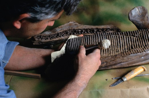 Stock Photo: 1598R-89625 Archaeologist Carving Matrix from T. Rex Jaw