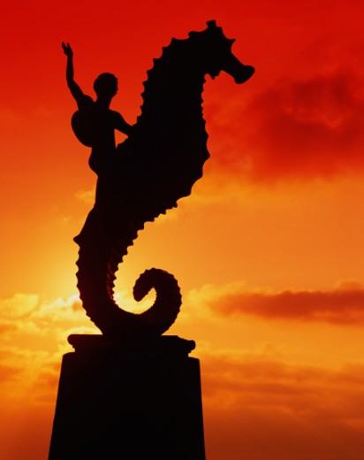 Stock Photo: 1598R-9089 Mexico, Puerto Vallarta, Seahorse Statue, silhouette, sunset