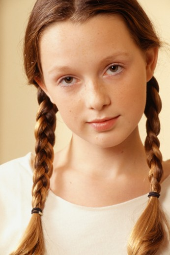 Teenage girl (13-14) with plaits, portrait : Stock Photo