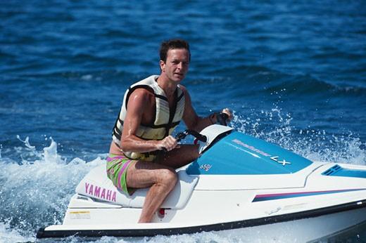 Man riding jet boat : Stock Photo
