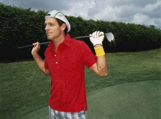 Man holding golf club across shoulders : Stock Photo