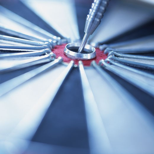 Close-up of a Dart in a Bullseye : Stock Photo