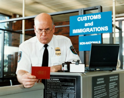 Stock Photo: 1598R-9940306 Passport Officer at Airport Security