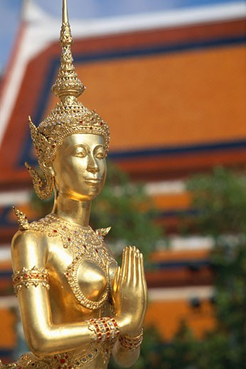 Kinaree statue outside the Emerald Buddha Temple at Wat Phra Keo, Grand Palace complex, Bangkok, Thailand : Stock Photo