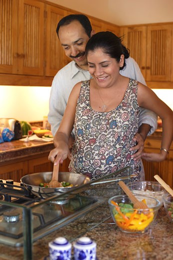 Couple in kitchen, cooking : Stock Photo