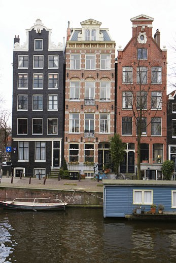 Stock Photo: 1598R-9941343 Holland, Amsterdam, houseboat on canal