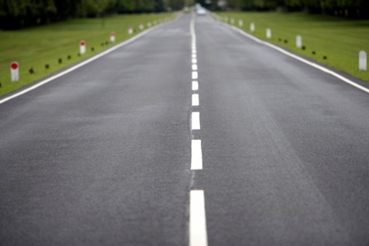 Stock Photo: 1598R-9942092 Straight road leading to vanishing point