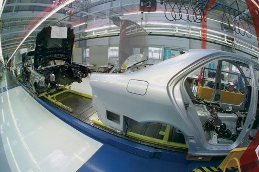 Stock Photo: 1598R-9943605 Cars Being Manufactured on an Assembly Line, Shot Through a Fish Eye Lens