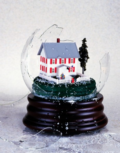Stock Photo: 1598R-9944806 Suburban house inside broken snowglobe
