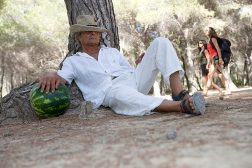 Stock Photo: 1598R-9945008 Mature man relaxing by tree