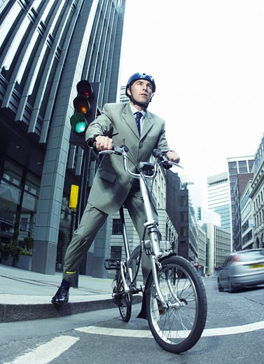 Stock Photo: 1598R-9945886 Businessman Riding a Bicycle