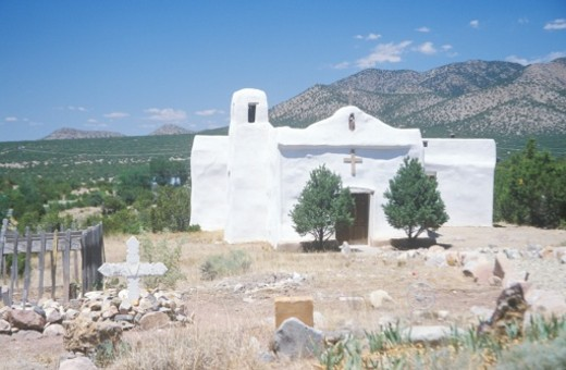 Stock Photo: 1598R-9947042 Old pueblo church located along Route 14 on the way to Madrid New Mexico