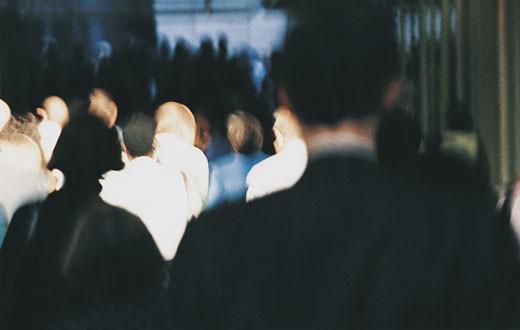 Pedestrians walking through shadows : Stock Photo