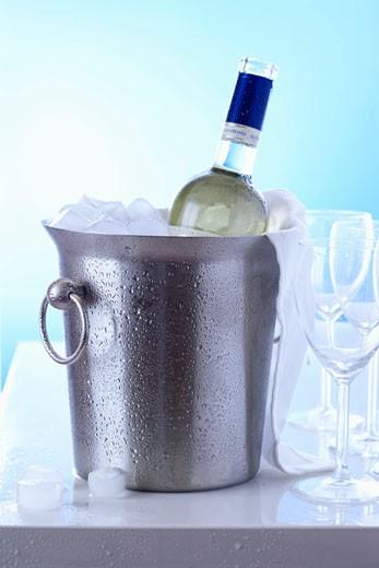 White wine in ice bucket : Stock Photo