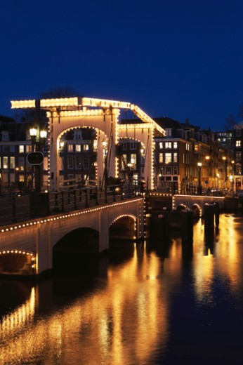 Netherlands, Amsterdam, bridge illuminated at night : Stock Photo