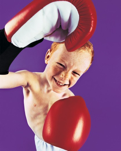 Stock Photo: 1598R-9948662 Portrait of a Boy Wearing Boxing Gloves