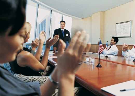 Stock Photo: 1598R-9948729 CEO Receiving Applause in a Boardroom Meeting