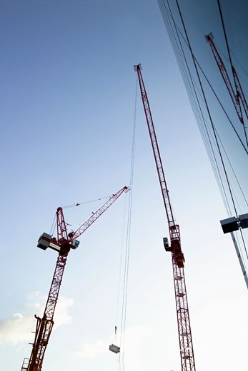 Stock Photo: 1598R-9949127 Cranes in a Building Site, Low Angle